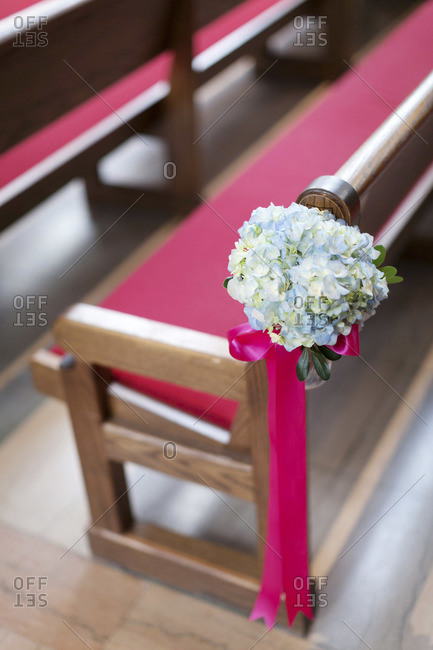Wedding bouquet on a chapel pew