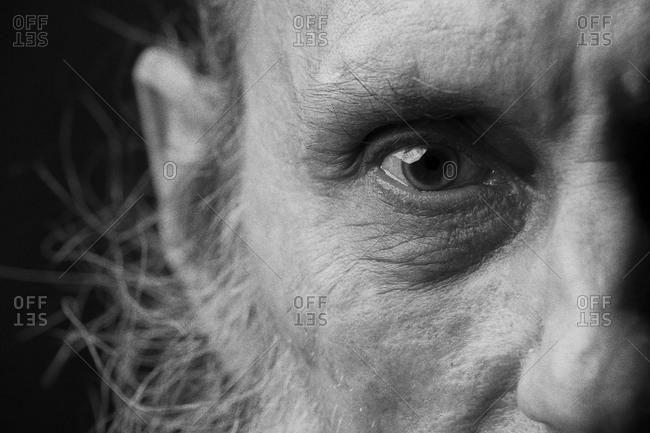 Close up view of an elderly man's eye with beard