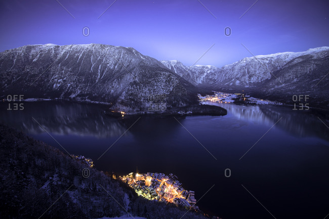 Hallstatt and lake with Dachstein mountains at night, Salzkammergut, Austria