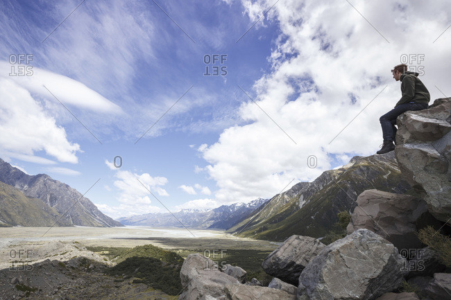 Man looking at valley of mount cook national park