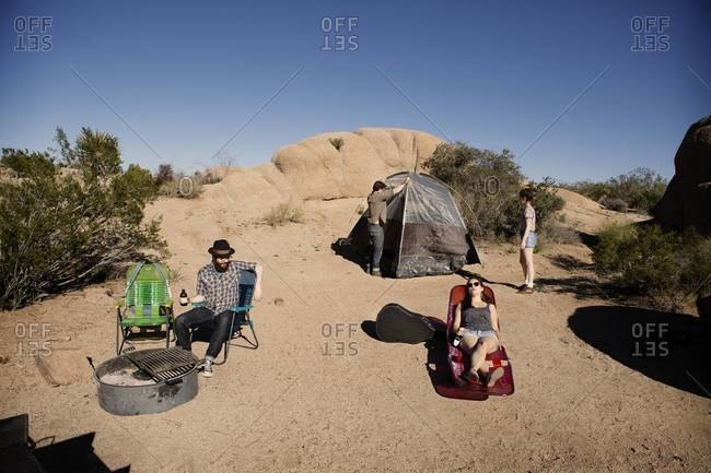 Hipsters camping in a desert