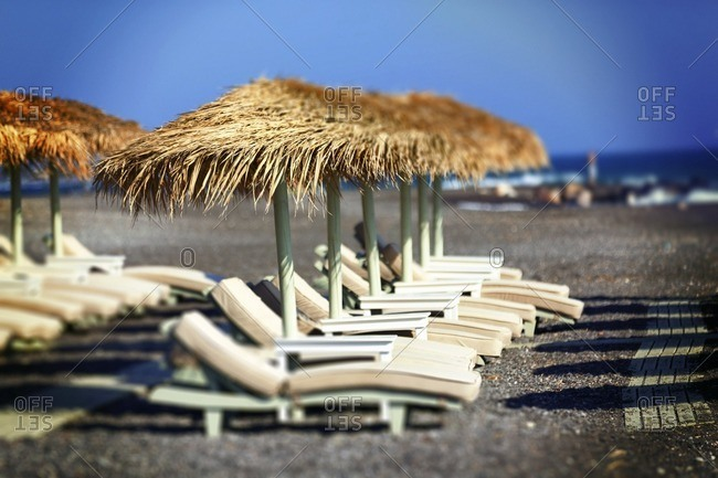 Sun loungers and parasols on an empty beach
