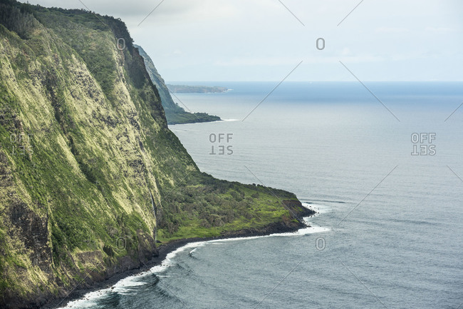Sea cliffs rise over the Pacific Ocean near Waipio valley on the Big Island of Hawaii