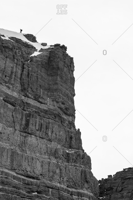 A BASE jumper inspecting possible exit's in the Wyoming backcountry