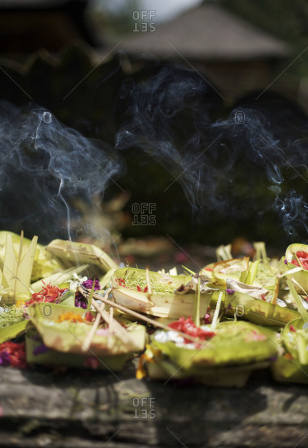 Canang Sari, little Hindu offering trays, are stacked atop a shrine at the Tirta Empul holy site near Ubud in Bali, Indonesia