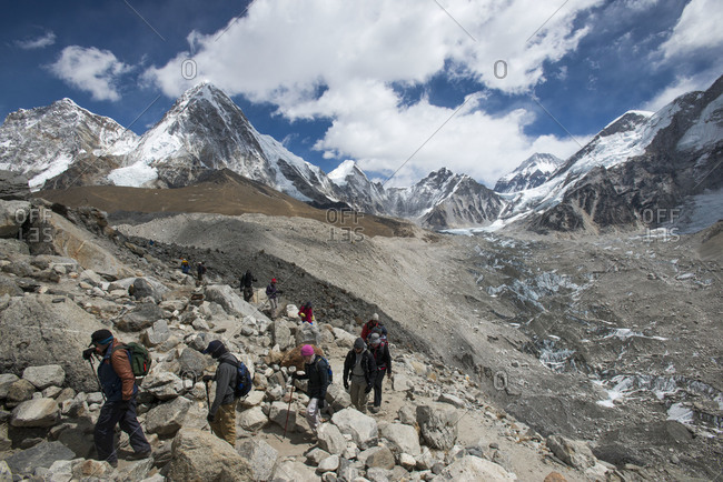Trekkers make their way down from Everest Base Camp beside the Khumbu glacier in Nepal