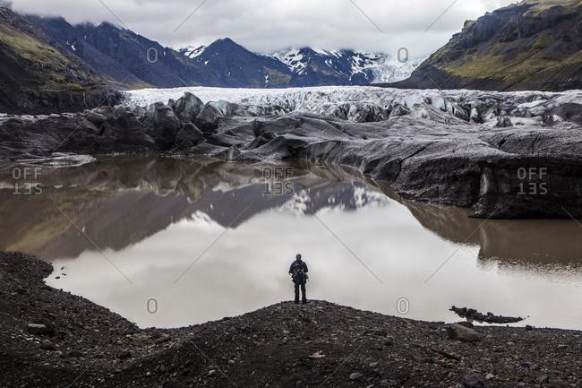 A man admires Sv�nafellsj�kull aka Pig Mountain Glacier