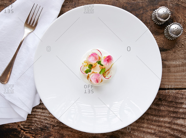 Top view of sashimi garnished with edible flowers