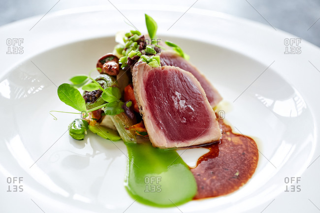 Red tuna steak garnished with vegetables