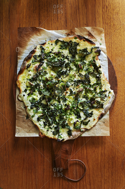 Vegetarian pizza with kale topping