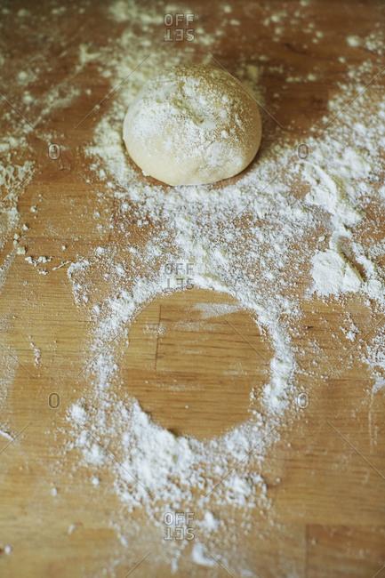 Pizza dough on a floured surface