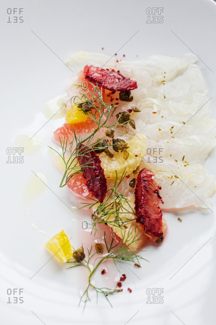 Fish fillets served with grapefruit and fennel