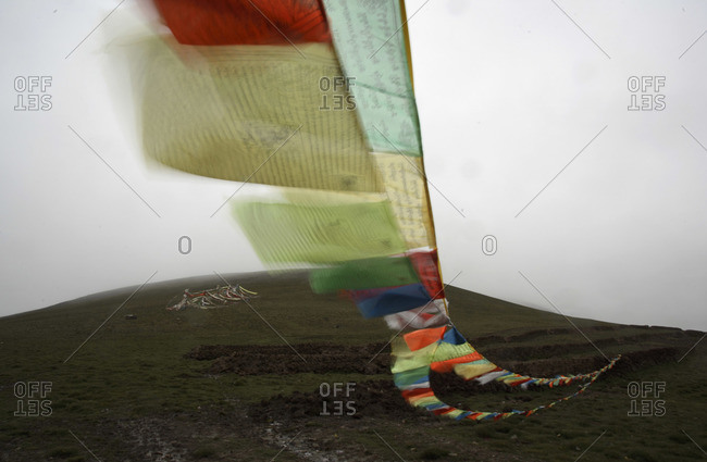 Buddhist prayer flags above a field in Central China