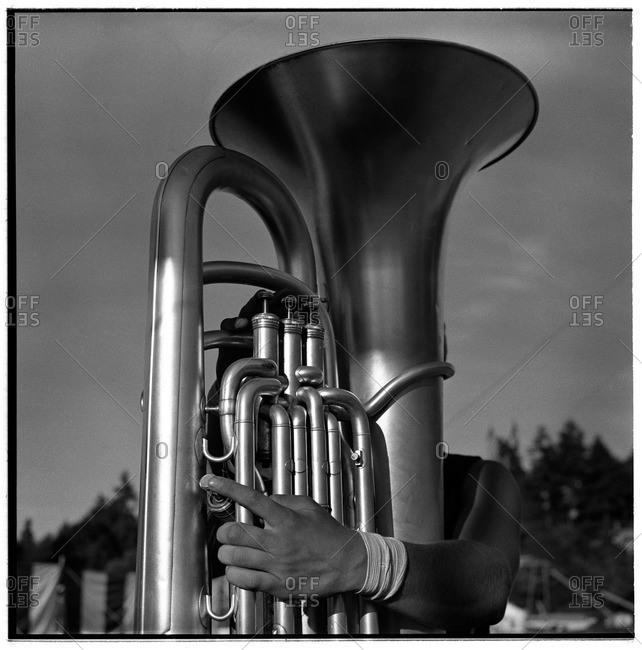 Tuba player hidden behind his instrument