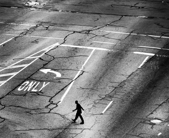 A man walks through a parking lot