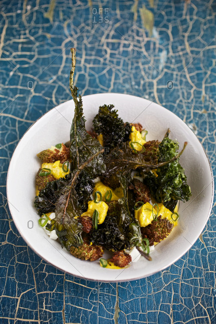 Roasted kale with cauliflower served with melted cheese