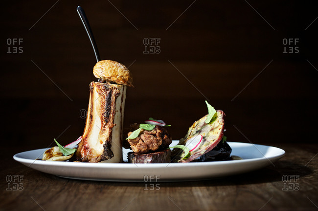 Bone marrow with a bun and radishes