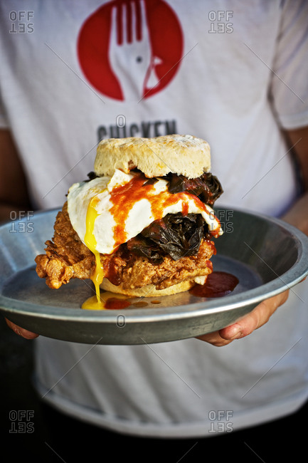 Biscuit sandwich with fried chicken and over-easy egg