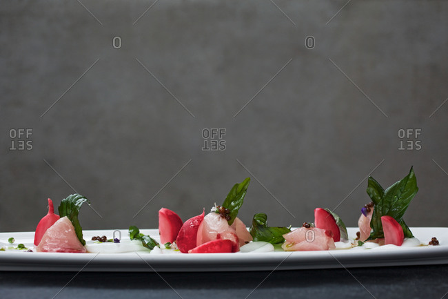 Striped jack sashimi with coconut and basil