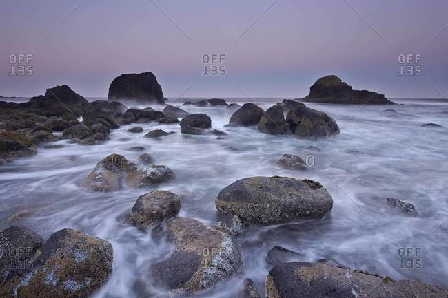 Surf, rocks, and sea stacks at dawn, Ecola State Park, Oregon, United States of America, North America