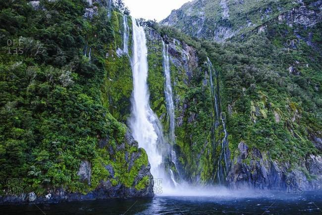 Huge Waterfall In The Milford Sound Fiordland National Park
