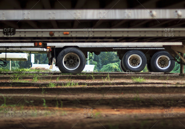 Low angle view of trailer truck wheels