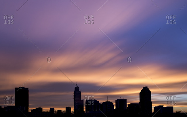Sunrise against skyline of Raleigh, North Carolina