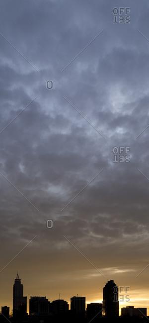 Sunrise against skyline of Raleigh, North Carolina