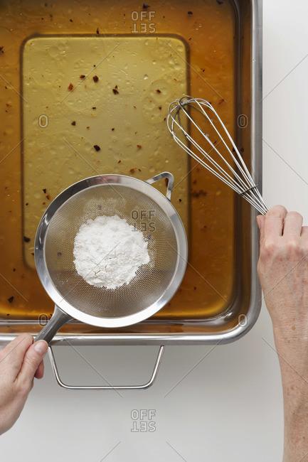Hands making gravy