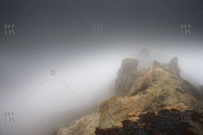 Fog over cliffs