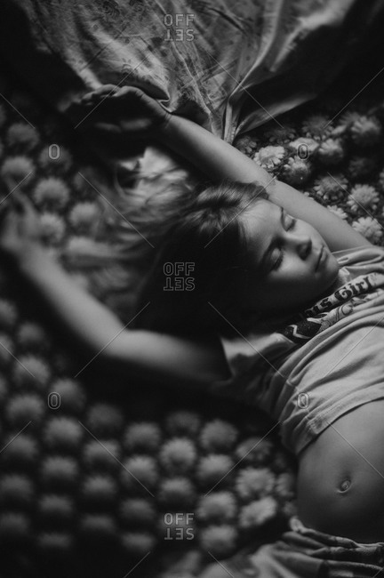 Girl sleeping in a bed