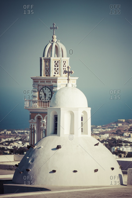 View to cupola and church spire of Holy church of John the Baptist, Thera, Santorini, Cyclades, Greece