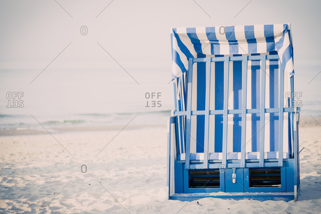 Closed beach chair on beach