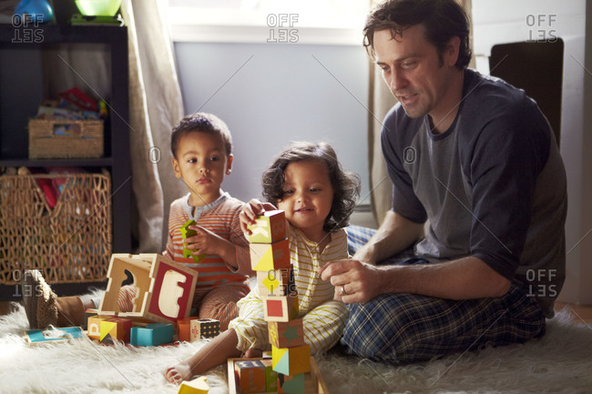 Father and kids playing with building blocks