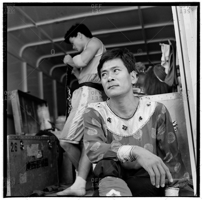 Burlington, Iowa - 1996: Two performers from the Chinese Imperial Circus in a portable dressing room before the start of a performance