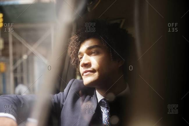 Businessman looking out cab window