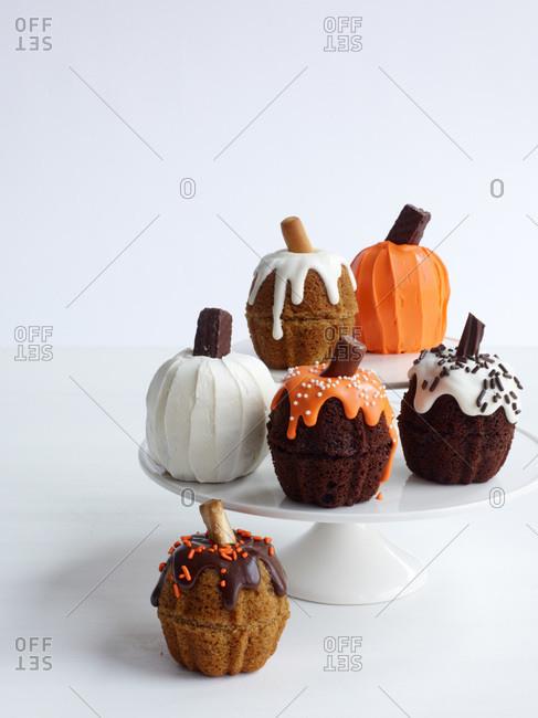 Mini pumpkin cakes on a cake stand