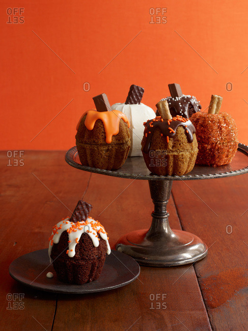 Mini pumpkin cakes on a vintage cake stand