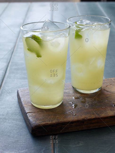 Tequila oasis cocktails served with lime twist
