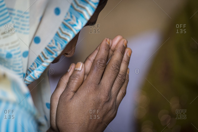 Christian woman praying in India