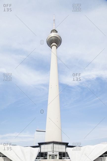 Low angle view of communication tower against cloudy sky, Alexanderplatz, Berlin, Germany
