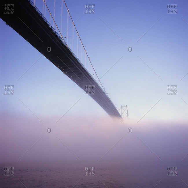 Lions Gate Bridge over sea in fog, Vancouver, Canada