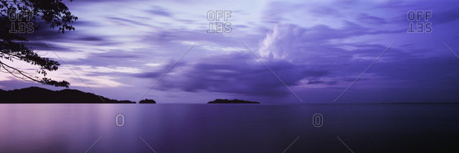 Tranquil view of purple sea against cloudy sky, Solentiname, Nicaragua