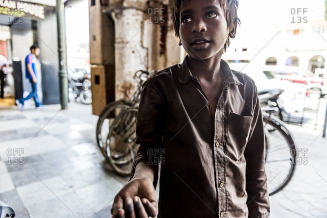 Lucknow, India - April 25,2014: Boy begging in India