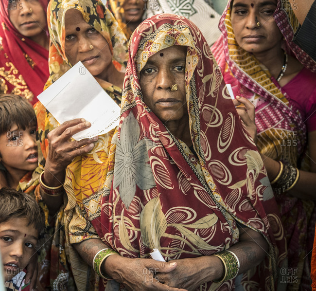 Madhya Pradash, India - April 29,2014: A crush of people waiting to enter the village medical clinic in India