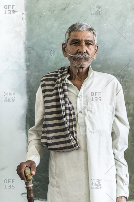 Madhya Pradash, India - April 29,2014: Elderly man waiting to be examined at a medical clinic in India