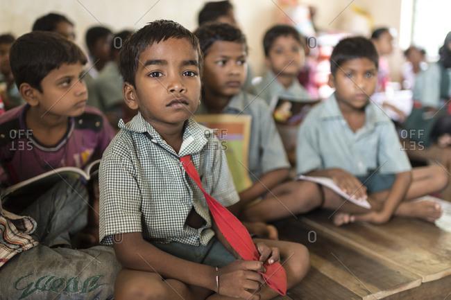 Orissa, India - May 2,2014: Deaf children sitting in a school