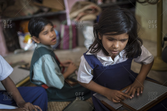 Orissa, India - May 2,2014: Blind children studying braille in an Indian school