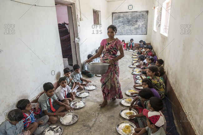 Orissa, India - May 2,2014: Lunchtime at a small home and school for deaf and blind children in India