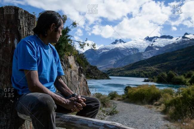 Patagonia, Chile - February, 16, 2012: A man looks upon the mountainous Chilean landscape in Patagonia
